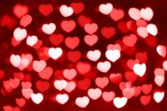 Rotes und weißes Herzen bokeh als Hintergrund Lizenzfreie Stockbilder