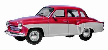 Rotes und weißes Spielzeugauto Stockfotos