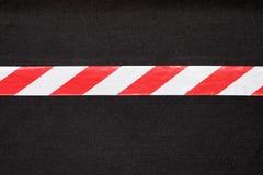 Rotes und weißes warnendes Band Lizenzfreie Stockbilder