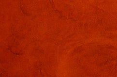 Rotes Veloursleder Stockbild