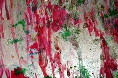 Rotes violettes hellgrünes Silber spritzt, bunte klare wächserne Farben, kreativer Hintergrund der Kontraste Lizenzfreie Stockbilder