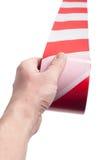 Rotes weißes Schnurband in der Hand Stockfotos