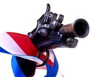 Rotes weißes u. blaues Farbband u. Gewehr Stockfoto