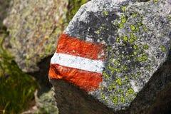 Rotes, weißes und rotes touristisches Kennzeichen Stockfotografie