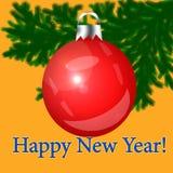 Rotes Weihnachten-Baumspielzeug auf einem orange Hintergrund Lizenzfreies Stockbild