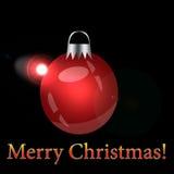 Rotes Weihnachten-Baumspielzeug auf einem schwarzen Hintergrund Lizenzfreies Stockbild