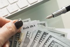 Roth IRA, individual retirement account, plan with cash us dollars on a table stock image