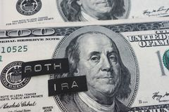 Roth IRA labels. On hundred dollar bills royalty free stock photos
