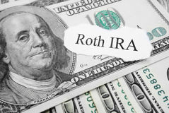 Roth IRA. Paper message on hundred dollar bills royalty free stock photography