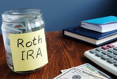 Roth ira written on a label of jar with money. Roth ira written on a label of the jar with money stock photo