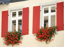ROTHENBURG, GERMANY/EUROPE - SEPTEMBER 26 : Beautiful flower baskets beneath windows in Rothenburg Germany on September 26, 2014 royalty free stock image