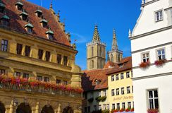 Rothenburg town hall and church stock photography