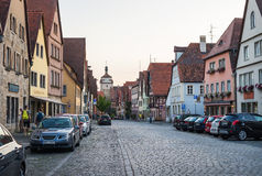 ROTHENBURG-OB-DER-TAUBER, GERMANY - JULY, 19. Street view with medieval buildings, cars and unknown people walking in Royalty Free Stock Photography