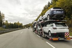 Rothenburg ob der Tauber, Germany - October 12, 2017: The trailer truck transports brand new cars on highway. royalty free stock photography