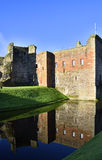 Rothesay Castle. View of section of the ruins of Rothesay castle showing vivid reflection in moat, Isle of Bute, Scotland stock photo