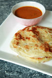 Roti canai. This is known as 'roti canai' in Malaysia, a traditional Indian food royalty free stock image