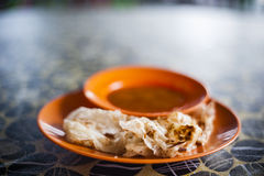 Roti Canai. Is a famous Malaysian food made of flour normally served with curry or dhal at Malay, Mamak or Indian stalls or restaurant in the morning as stock images