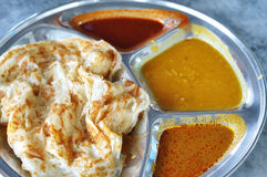 Roti canai flat bread, Indian food. Made from wheat flour dough. Famous malaysian dish, Roti canai and curry Royalty Free Stock Photography