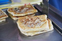 Roti canai. This indian food is called Roti Canai, popular in Malaysia royalty free stock photo