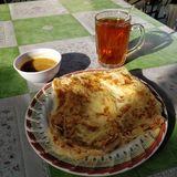 Roti canai. Malaysian style and favorite food called roti canai with tea and curry Stock Photography