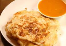 Roti canai is a popular Malaysian dish. Royalty Free Stock Photos