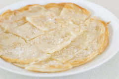 Roti Canai Pour Condensed milk and sprinkle sugar on top,cut int Royalty Free Stock Image