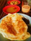 Roti canai is a popular Malaysian dish. Stock Photo