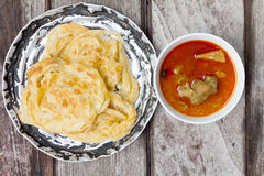 Roti canai with spicy curry Royalty Free Stock Photos