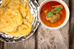 Roti canai with spicy curry Stock Images