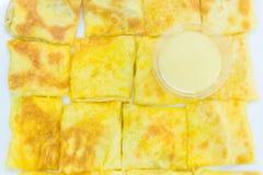 Roti com leite condensado abrandado imagem de stock