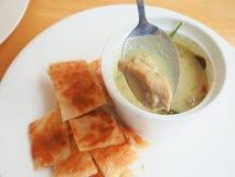 Roti con curry Immagini Stock