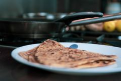 Roti or flat bread - being made fresh in a shallow pan. stock image