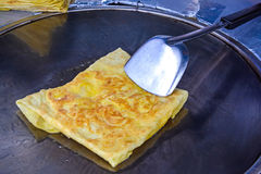 Roti frying Stock Photos