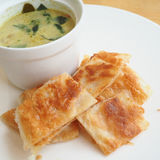 Roti with green curry Stock Photography