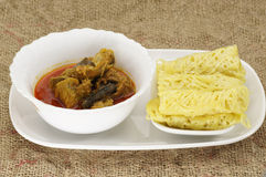 Roti Jala and Chicken Curry Royalty Free Stock Image