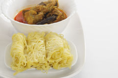 Roti Jala and Chicken Curry Stock Photos