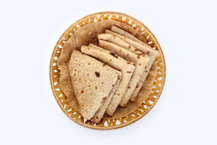 Roti Paratha isolated on white. Indian Bread in wooden Basket Stock Photos