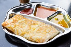 Roti prata or canai set with curry, dhal and sambal stock images