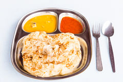 Roti Prata or Roti Canai, a traditional Indian bread served with curry Stock Photos