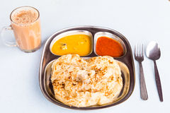Roti Prata or Roti Canai, a traditional Indian bread served with curry Stock Photography