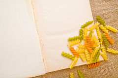 Rotini and open book Stock Photos