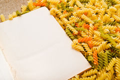Rotini and open book Royalty Free Stock Photos