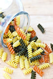 Rotini pasta. Tri colored rotini pasta in a glass jar Royalty Free Stock Photography