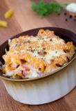 Rotini spiral pasta gratin on table Royalty Free Stock Image