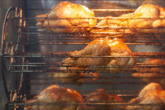 Rotisserie chicken on a grill Royalty Free Stock Photography