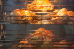 Rotisserie chicken on a grill Stock Photo