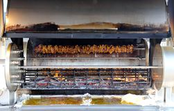 Rotisserie full of cockerels and roast chickens Royalty Free Stock Photography
