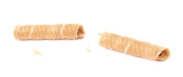 Roto en los palillos del wafel de los pedazos aislados sobre el fondo blanco Fotos de archivo