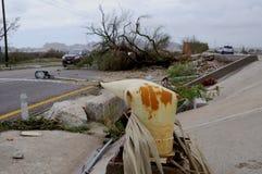Roto por los posts de la luz del huracán Imágenes de archivo libres de regalías