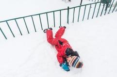 Rotolando sulla neve Fotografia Stock Libera da Diritti
